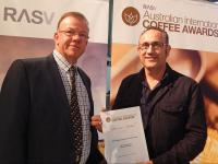 Cafe2U National Training Manager, Mr Dino Demetriou proudly accepts the Bronze Medal Award from the CEO RASV, Mr Mark O'Sullivan