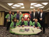 Mr. Takuya Hara and Mr. Kazu Tohda (center) were presented with a custom made surf board to commemorate the agreement.