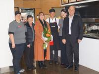 Staff from the Noodle Box restaurant, Devonport, with Alison Jarman, Max Employment and Ian Martin, CEO Noodle Box