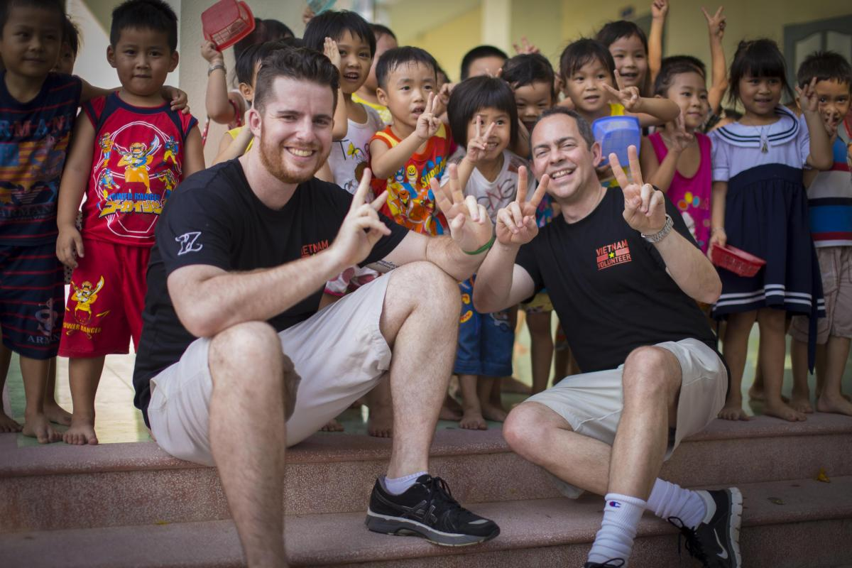 Zambrero CEO Stuart Cook and Stop Hunger Now CEO Rob Brooks with kindergarten kids in Quang Nam province outside of Danang