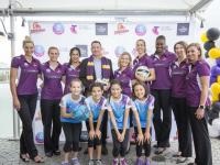 Firebirds players with The Coffee Club CEO Jason Ball and Netball Queensland CEO Catherine Clark and junior NetSetGo players