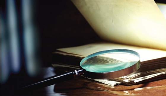 Magnifying glass on papers